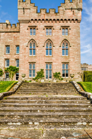 Stone steps outside Hutton in the Forest country estate in Skelton, Cumbria, England against blue skies on sunny day.