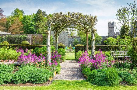 Trellis and flower beds in gardens on grounds of Hutton in the Forest in Cumbria, England. Stock Photo