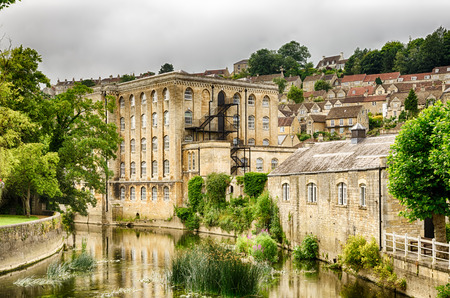 Exterior of old mill building on River Avon in Bradford on Avon, Wiltshire, England on sunny day. Stock Photo