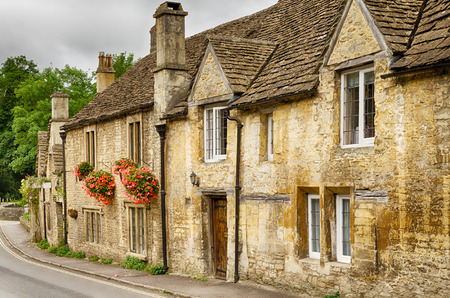 Flower boxes on stone houses in Castle Combe Village in Wiltshire, England. Stock Photo