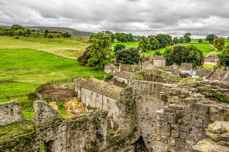 3rd ancient: English countryside around Middleham, North Yorkshire, in late Summer. The castle is surrounded by green fields and trees and is a tourist attraction.