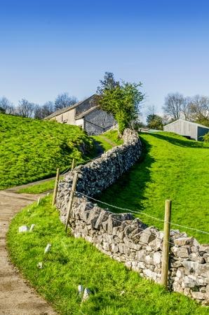 English country lane leading to a farmhouse.