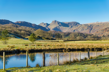 The Langdale Pikes seen from Elterwater Stock Photo