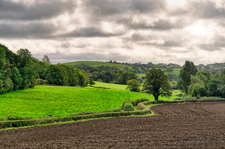 A rural English scene with a ploughed field.