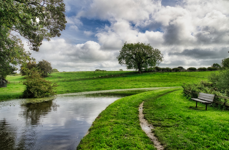 The Lancaster canal passing through rural countryside. 免版税图像