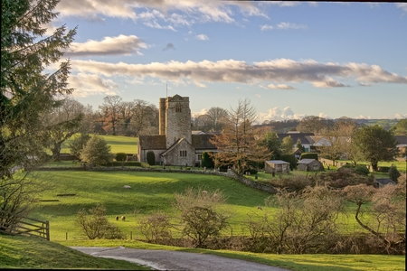A view of A view of St Bartholomews Church and the village of Barbon