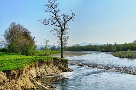 A scenic section of the River Lune near Lancaster. 免版税图像