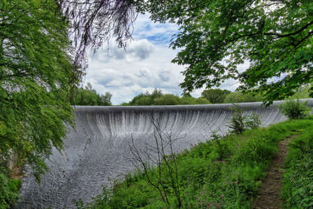 water cascading over a dam in the Forest of Bowland, Lancashire, England 免版税图像