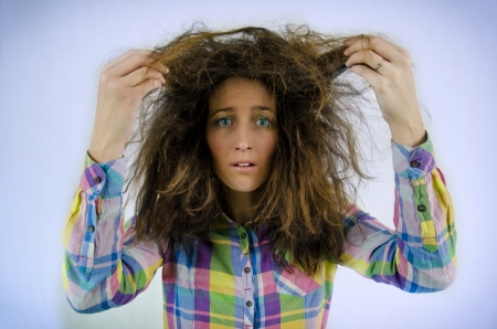 Young beautiful girl in a shirt with tousled hair photo