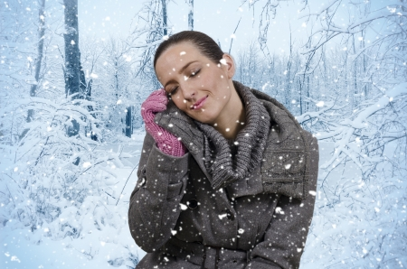 snows: Young beautiful woman in nature when it snows
