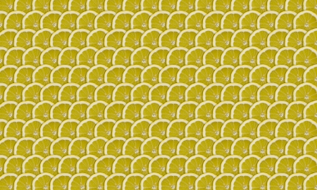 organics: thin lemon slices folded into rows as background Stock Photo