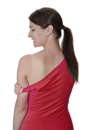 young woman tan shirt to the skin on her shoulder Stock Photo - 19761379