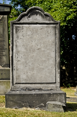 buried: blank headstone in a cemetery Stock Photo