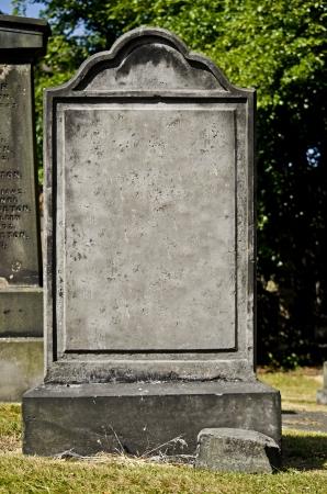 Lapide in bianco in un cimitero Archivio Fotografico - 21205591