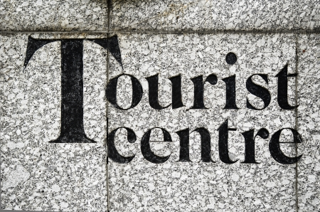 inscribed: Tourist center inscribed on a stone wall Stock Photo
