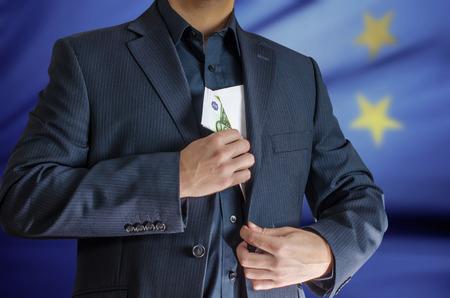 enveloped: man has enveloped euro banknotes