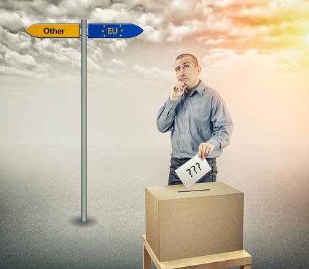 ballot box: The man at the ballot box voting