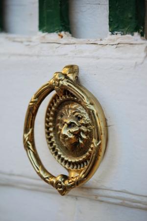 doorhandle: White door with golden doorhandle, Malta, 2011