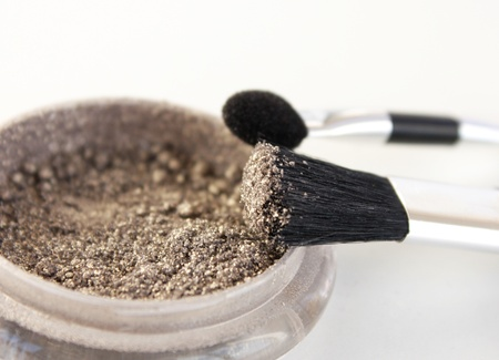 eyemakeup: Close-up eyeshadow  and two brushes in the center Stock Photo