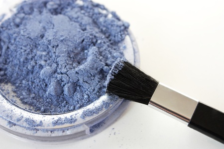 eyemakeup: Blue eyeshadow  and a brush