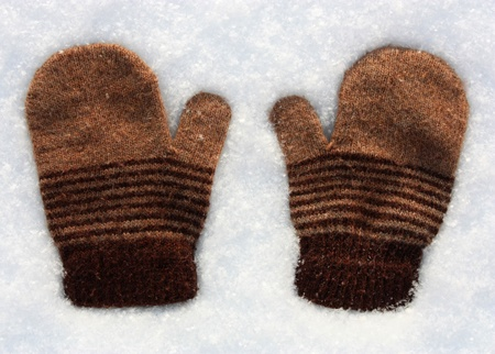 cold weather: Knitted mittens lost by somebody on the snow