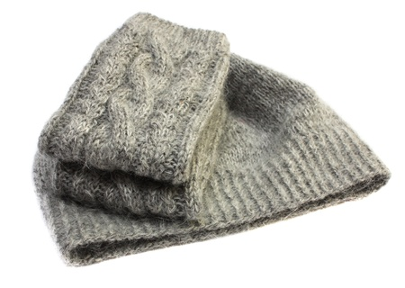 knitten: Gray knitted wool hat with mittens isolated on white background