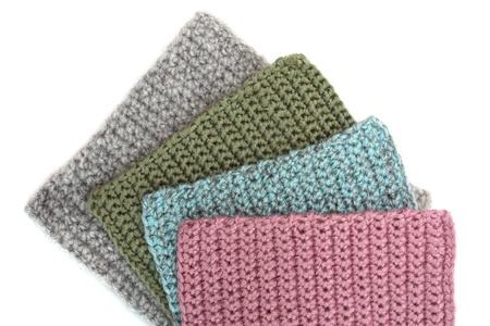Crocheted geometric patterns on white background Stock Photo - 21931264