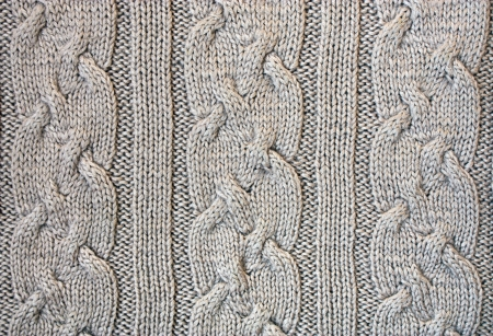 bulging: Knitted cloth is made by hand. It is decorated with bulging pattern.   Stock Photo