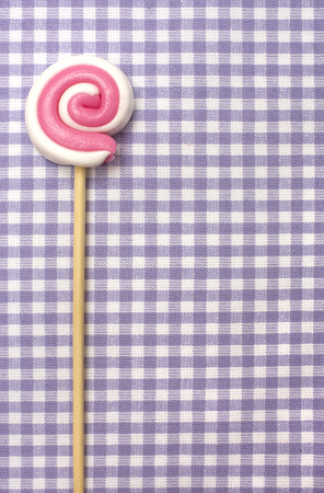 lolly pop: Spiral lolly pop candy  on background in purple cellule