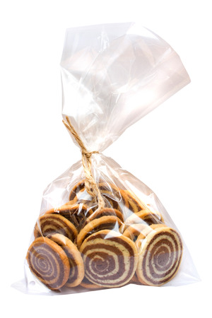 Roll cookies in  transparent bag on white background