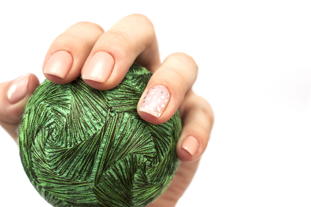 Temari ball  in hands with a beautiful manicure Foto de archivo