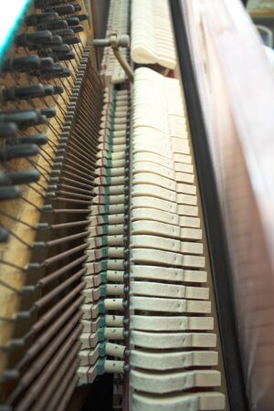 Closeup of brown wooden piano keys