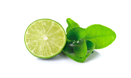 Lime with leaf isolated on white background. photo