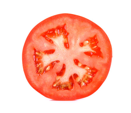 Slice tomato isolated on the white background.