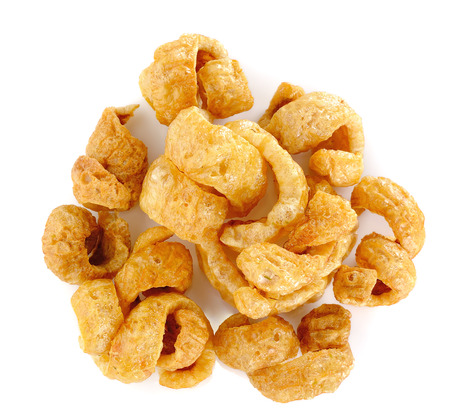 chicharon: Pork rind favorite food in Thailand (Lanna) isolated on white.
