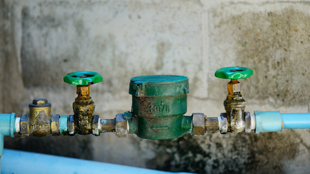 waterspout: water pipe and meter with waterspout. Stock Photo
