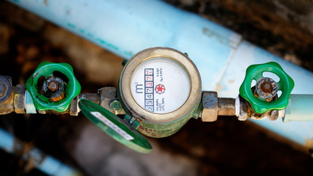 water pipe and meter with waterspout. Stock Photo