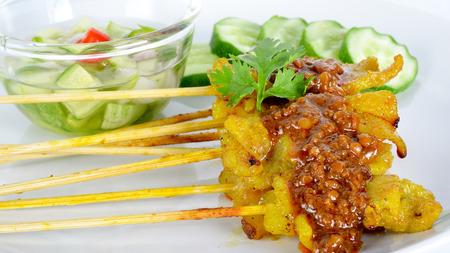 peanut sauce: Grilled Pork Satay with Peanut Sauce and Vinegar.