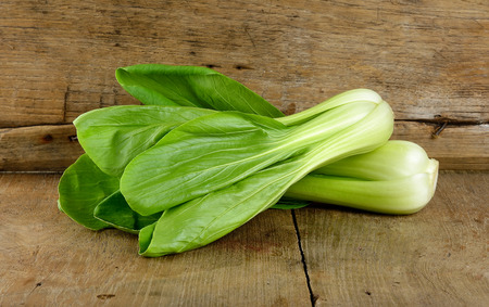 Bok choy vegetable on the wooden background.