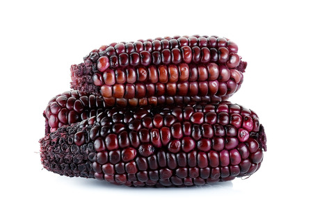 free radicals: Red corn isolated on the white background . Stock Photo