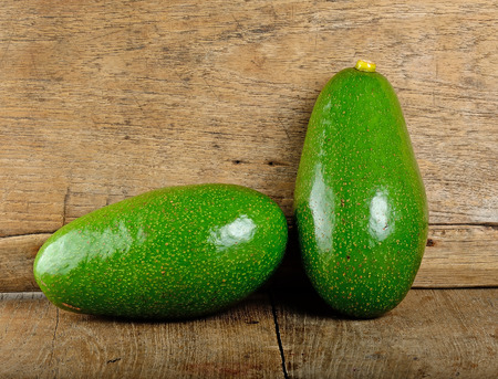 hass: Avocado fruit on the wooden background .