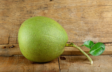 pomelo: Pomelo fruit on the wooden background.
