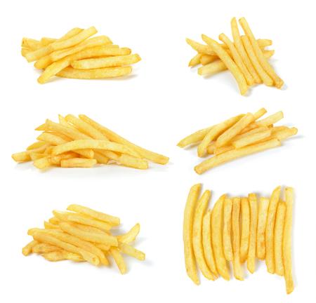 papas fritas: las patatas fritas aisladas en el fondo blanco. Foto de archivo