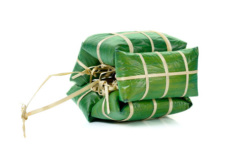 fermented: fermented ground pork in banana leaf packing isolated