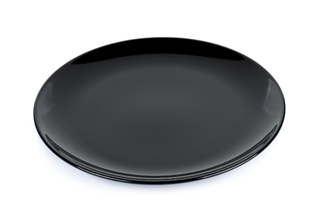 Black plate isolated on the white background.
