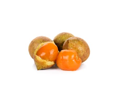 laxative: Schleichera oleosa (Lour.) Oken fruit isolated on white background. Stock Photo