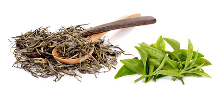 Dried white tea leaf with wooden spoon isolated