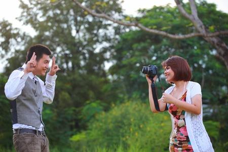 banter: women and man take a photo