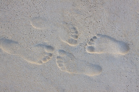 2 way: couples of foot print on sand beach