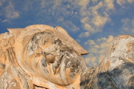 budda: face of buddha statue and blue sky